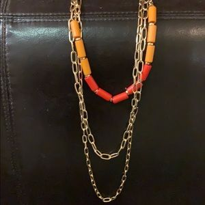 Gold necklace with orange & red beads (3 tiers)